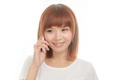 Femme avec le téléphone sans fil Image libre de droits