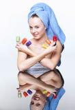 Femme avec le vernis de clou Image libre de droits