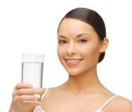 Femme avec le verre de l'eau Photos stock