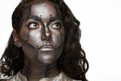 Femme avec le visage en métal photo stock