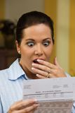 Femme avec les factures impayées Photographie stock