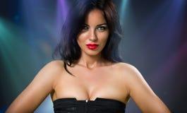 Femme avec les languettes sensuelles Photographie stock