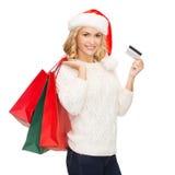 Femme avec les paniers et la carte de crédit Photo libre de droits