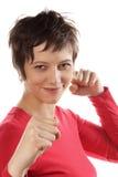 femme avec les poings augmentés images stock