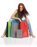 Femme avec les sacs à provisions colorés Image libre de droits