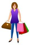 Femme avec les sacs à provisions et la bourse de sac à main Photo libre de droits