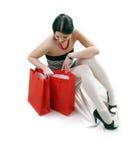 Femme avec les sacs rouges de cadeau Photos stock