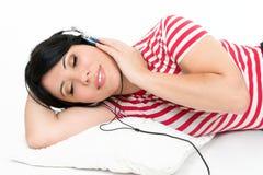 Femme avec sa musique préférée Photographie stock libre de droits