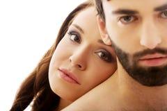 Femme avec sa tête sur le dos de l'homme Photo stock