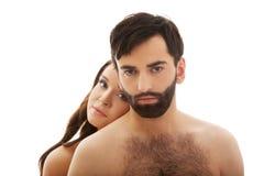 Femme avec sa tête sur le dos de l'homme Image stock