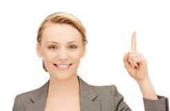 Femme avec son doigt vers le haut Photo stock