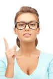 Femme avec son doigt vers le haut Photographie stock