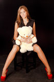 Femme avec teddybear Photographie stock libre de droits