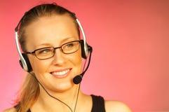Femme avec un écouteur photographie stock libre de droits