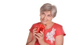 Femme avec un cadeau Photos libres de droits
