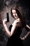 Femme avec un canon Photographie stock