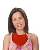 Femme avec un coeur rouge Photos stock