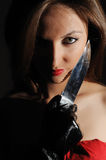Femme avec un couteau Photographie stock libre de droits