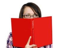 Femme avec un livre Photographie stock