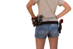 Femme avec une arme à feu sur sa ceinture d'isolement photo libre de droits