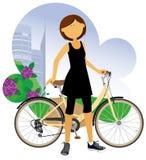 Femme avec une bicyclette. Photos libres de droits