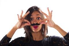 Femme avec une fausse moustache Photo stock