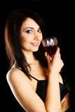 Femme avec une glace de vin. Photo libre de droits