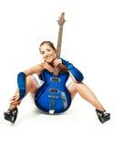 Femme avec une guitare Photos stock