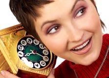 Femme avec une horloge image libre de droits