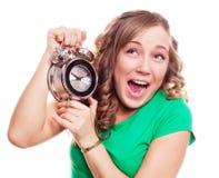 Femme avec une horloge d'alarme Photographie stock libre de droits
