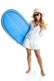 Femme avec une planche de surfing images stock