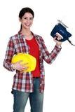 Femme avec une scie sauteuse électrique Photo libre de droits