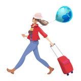 Femme avec une valise sur des roues Photos stock