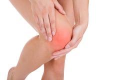 Femme ayant la blessure à la jambe Images libres de droits