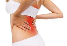 Femme ayant la douleur dorsale Photo libre de droits