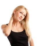 Femme blond avec le mal de tête Photographie stock