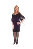 Femme blond dans la robe noire images stock