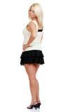 Femme blond mûr dans la mini jupe images stock