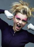 Femme blonde agressive photographie stock