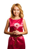 Femme blonde attirante retenant une fleur Photo stock