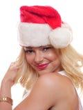 Femme blonde avec le chapeau de bas de Noël Photos stock