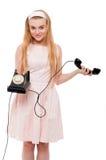 Femme blonde dans la robe rose d'isolement Photo stock