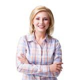 Femme blonde de sourire attirante sur le blanc Photo libre de droits