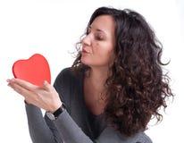 Femme bouclée avec un coeur Photographie stock