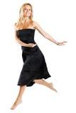 Femme branchant avec la robe noire image libre de droits