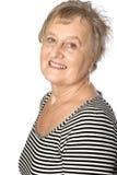 Femme caucasien mûr dans le dessus stripy occasionnel Photographie stock libre de droits