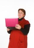 Femme caucasienne dans orange et bleu Photographie stock libre de droits