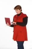 Femme caucasienne dans orange et bleu Photos stock