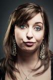 Femme caucasienne faisant à A Qu'est ce que visage Photographie stock