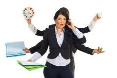 Femme chargée occupée d'affaires Image libre de droits